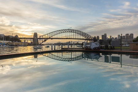 sydney harbour bridge: Beautiful sunrise scene at Sydney Harbour Bridge with dramatic sky colour and reflection