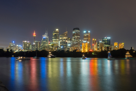 colorful lights: Beautiful scene of colorful Sydney city skyline at night with reflection