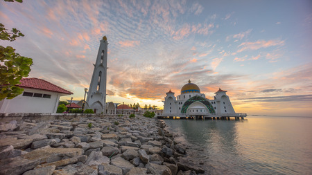 islamic scenery: Malacca Straits Mosque during beautiful dramatic sunrise. Stock Photo
