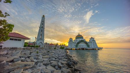 straits: Malacca Straits Mosque during beautiful dramatic sunrise. Stock Photo