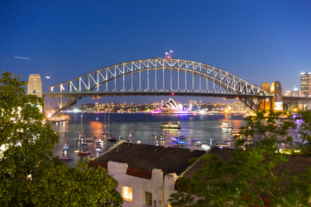 Sydney Harbor Bridge and Opera House view from Mcmahons Point at night Stok Fotoğraf