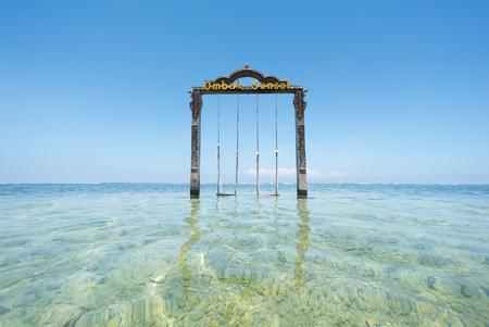 hotel indonesia: Lombok, Indonesia - March, 2016: Ombak Sunset Hotel swing at Gili Trawangan, Lombok Indonesia Editorial