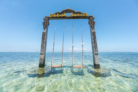 hotel indonesia: Lombok, Indonesia - March, 2016: Ombak Sunset Hotel swing at Gili Trawangan, Lombok Indonesia Editorial
