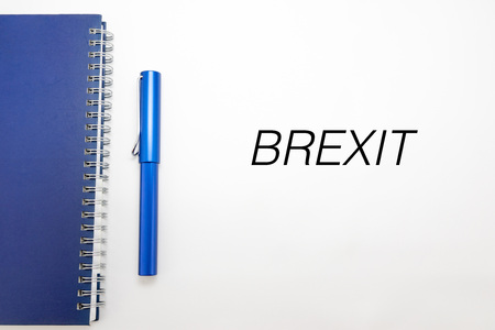 international crisis: Brexit Concept - Brexit word with notebook and pen isolated on white background