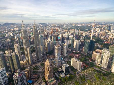 Kuala Lumpur, Malaysia - Jun 25, 2016: Aerial view of Kuala Lumpur city skyline during bright sunrise daylight.