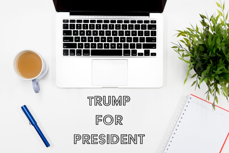 Kuala Lumpur, Malaysia - November 9, 2016: Word Trump For President with flat lay office concept background. Donald trump is the new United States President and Republican candidate for the 2016 presidential election Editorial