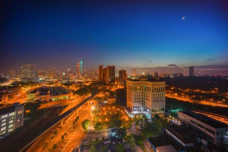 Aerial view of beautiful hazy sunrise at Kuala Lumpur city centre Stock Photo