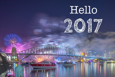 nsw: Happy New Year Holiday Hello 2017 Sydney concept with fireworks display at Sydney Harbour as a background