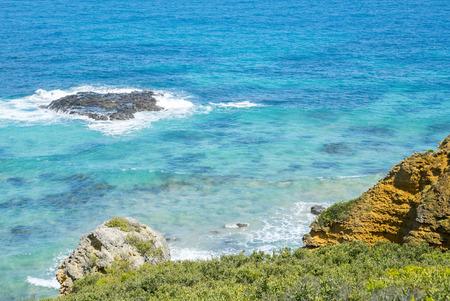 Coastline of a rocky beach along the Great Ocean Road, Victoria Australia Stock Photo