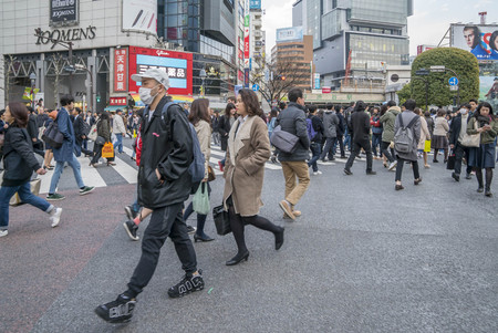 overcrowded: Tokyo, Japan - April 3, 2017: Pedestrians cross at Shibuya Crossing. It is one of the worlds most famous and claim to be a busiest scramble crosswalks. Editorial