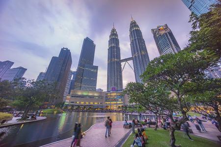 Kuala Lumpur, Malaysia - July 7, 2018: Sunset at Kuala Lumpur city skyline with Petronas KLCC Twin Towers and surrounding building Editorial
