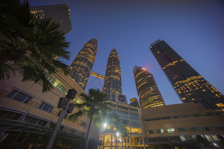 Kuala Lumpur, Malaysia - July 7, 2018: Sunrise at Kuala Lumpur city skyline with Petronas KLCC Twin Towers and surrounding building