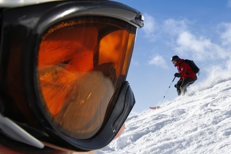 Goggle profile view with freeride scene as background photo