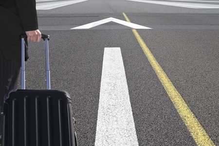 Traveller with trolley on an airport runway Stock Photo - 10346708