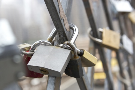 Love locks connected to the brooklyn bridge new york photo