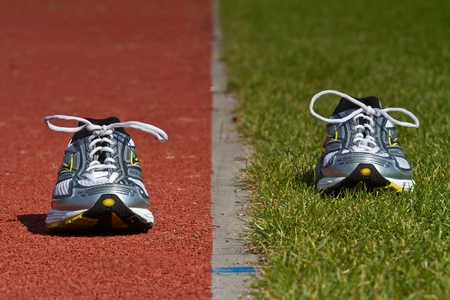 Empty runners on racetrack and green Stock Photo