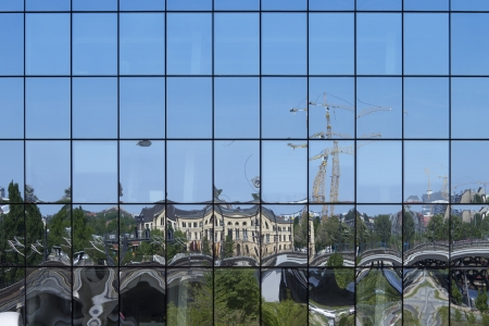 City reflection on the facade of a building