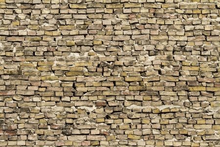 erratic: Loosely stacked up yellow bricks Stock Photo