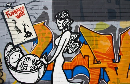 Graffiti of a woman with buggy as a main motive of the artwork photo
