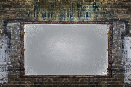 Filthy brick wall with empty framed board photo