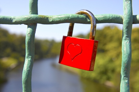 coined: Red love lock with embossed heart. Stock Photo