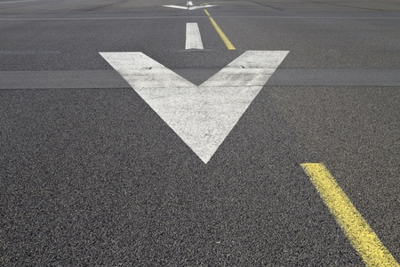Arrows on the surface of a runway Stock Photo - 10661188