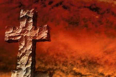 Stone cross braves firestorm Stock Photo - 10661183