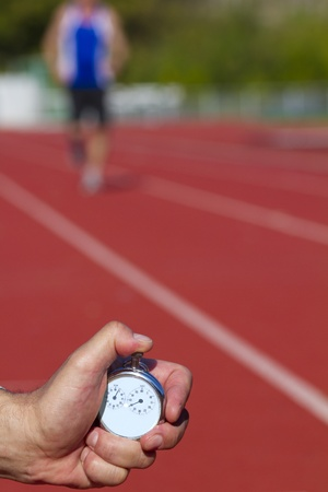 pista de atletismo: Medición del tiempo histórico parada reloj
