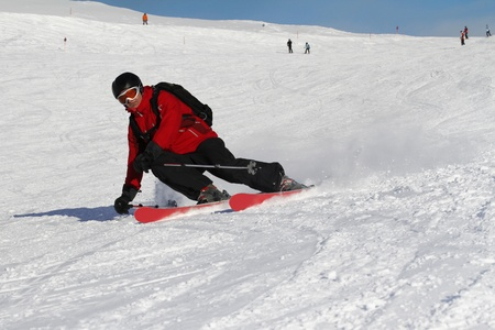 Furrowing turns with extreme sloping positions by a skier Stock Photo - 10882955