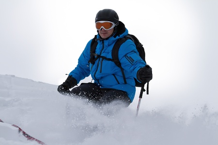 Male skier skiing backcountry photo