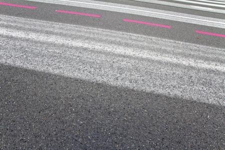 diagonally: Markings of a runway running diagonally through the image