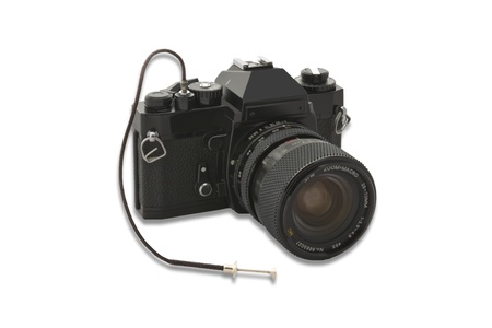 ancient analog camera isolated with wired remote control