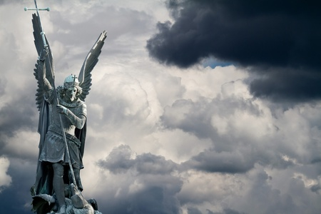 Archangel Michael fights the dragon photo