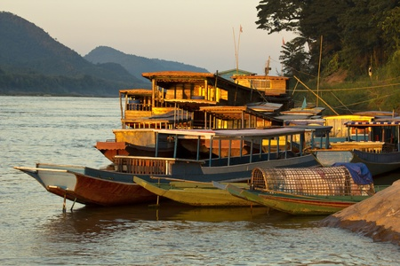 river bank: Ships anchored on the river bank of mekong river