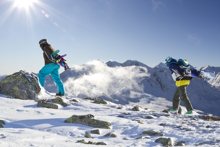 offpiste: Two boarder climbing up the mountain  Stock Photo