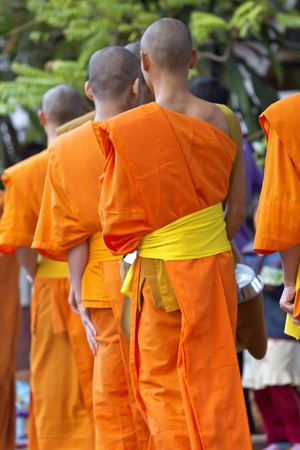 monks: Young mendicants begging tour in Laos Stock Photo