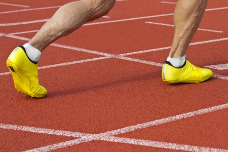 start position: Sprinter with spikes is in start position