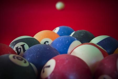 Billiard balls on a red  covered billiard table photo