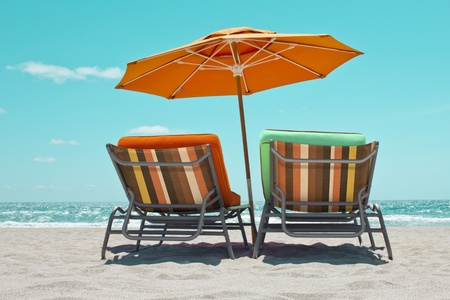 Empty sunbeds with parasol in Miami Beach photo