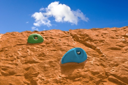Climbing wall with artificial handles photo