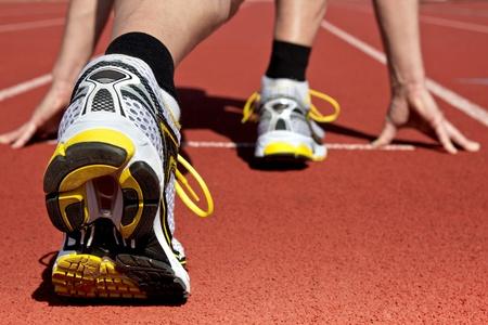 startpunt: Runner in het stadion wacht op zijn start Stockfoto
