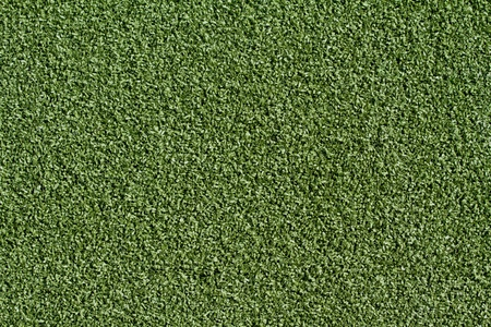 Brand new artificial grass of a field photo