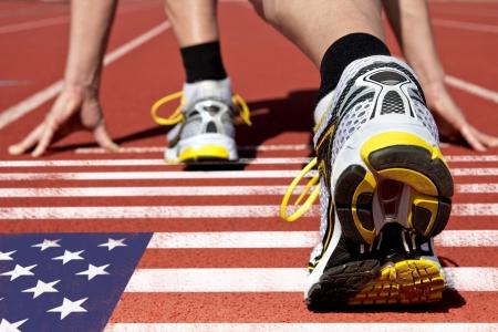 Runner on US flag waits for his start photo