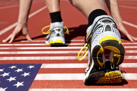 racer flag: Runner on US flag waits for his start Stock Photo