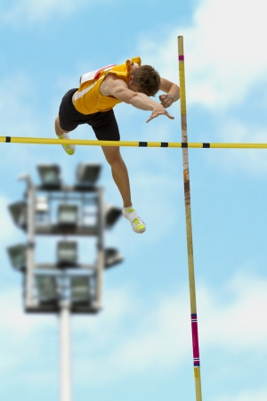 Pole vault over the bar photo