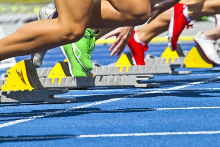 athletic girl: female sprinters start