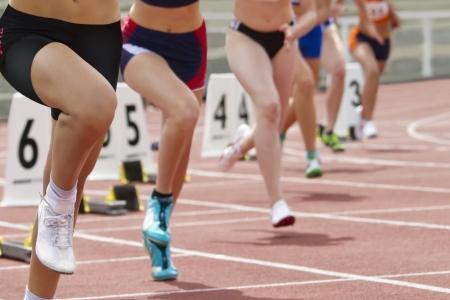 Female runners short track race start
