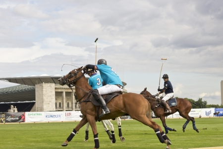 engel: BERLIN- AUGUST 12- Unidentified Polo players in fast action at Berlin Polo Cup competition  August 12, 2012 in Berlin, Germany.