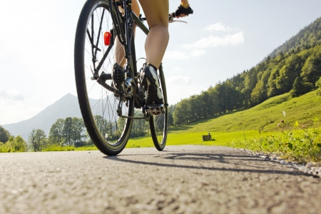 cycling in a surrounding of mountains