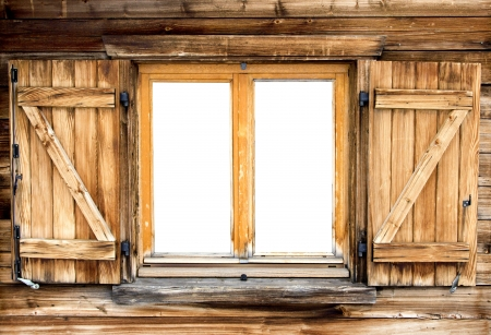 Weathered facade of a mountain hut with isolated windows
